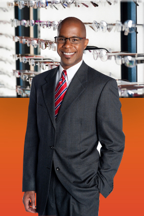 business man standing, in glasses